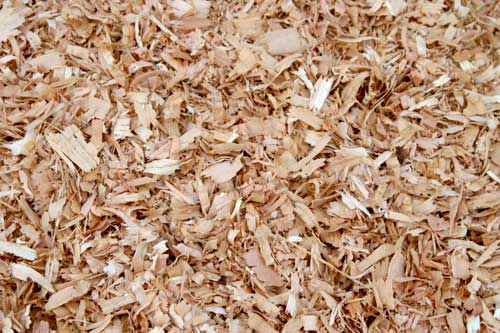 Wood shavings in block forms and other packaging
